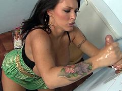 Have fun jerking off as you take a look at Jenna Presley's big round tits, wet pussy and great ass while she sucks on a big cock through a gloryhole.