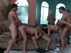 Press play to watch Jamie Elle, Devon Monroe, Emma Cummings, Emma Heart and Jenny Tores having group sex with several men in a living room.