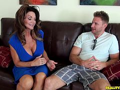 Brown-haired mom Deauxma shows her big fake boobs to a man and pleases him with a blowjob. They fuck in the reverse cowgirl position and doggy style and seem to enjoy it a lot.