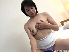 Kinky Japanese milf, wearing panties, is having fun with a man indoors. She lets the dude watch her masturbating her cunt, then kneels in front of the stud and sucks his wang.
