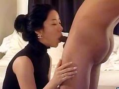 Elegant brunette chick from Korea gives her man sensual blowjob. Honey blows his dick sitting on her knees and then attacks that prick her mouth in bed.