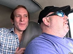 Two horny queers are having a nice time in a minivan. One of the men favours the other with a blowjob and lets him drill his ass in the missionary position.