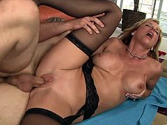 Sizzling blonde milf Jody West favours a stud with a passionate blowjob. After that she takes the man's boner in her shaved pussy and enjoys sex in the cowgirl, the missionary and other positions.