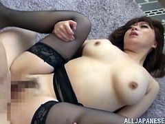 Ravishing Asian sweetie with big natural boobs and smooth ass wearing black nylon stockings gives a titfuck to the dude. Thereafter she gets her bushy muff drilled mish.