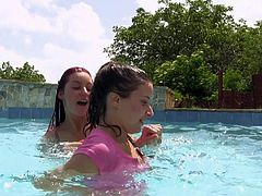 Busty redhead enchantress and adorable brunette cutie swim in the pool getting horny together. Then girls impale each other's drooling clams with a dildo.