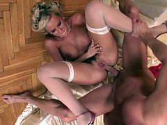Click to watch this blonde wife, with huge fake jugs wearing nylon stockings, while she gets fucked in different positions and moans like a kinky MILF.