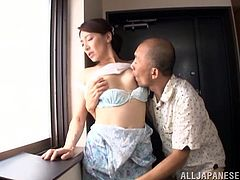 Horny Japanese mom Marina Matsumo is having fun with a dude indoors. The guy eats the milf's coochie, then drills it from behind.