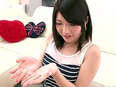 Go wild as you watch this Japanese girl, with a big mouth wearing a cute dress, while she uses her pie hole and hands to satisfy a guy's dream.