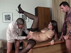 Luxurious dark-haired seductress with big natural boobs wearing black stockings gives dude titfuck and gets her clam doggyfucked. Then she jerks off two cocks and gets a load of cum on her marvelous melons.