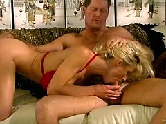 Have fun watching this blonde pornstar, with enormous fake tits wearing high heels, while she goes hardcore with a lusty man in a retro video.