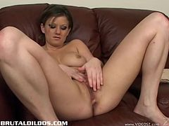 Go crazy as you watch this brunette babe, with natural gazongas and a shaved pussy, while she touches herself in a solo model video.