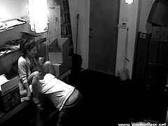A slutty brunette and her BF are getting naughty indoors. They pet each other and fuck in the missionary position. They haven't got an idea that there is a security cam in this room.