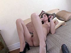 Get a boner by watching this brunette babe, with small tits wearing high heels, while she has interracial sex with a giant black cock.