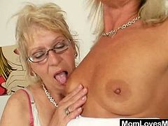 This sexy mature lesbians get incredibly horny as they finger their pussies and fuck each other hard with a big strap on dildo.