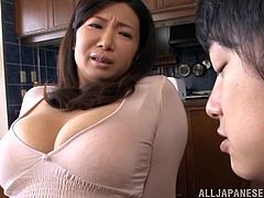 Entertain yourself by watching this mature brunette, with big tits wearing a miniskirt, while she uses her hands and mouth to drive a man crazy.