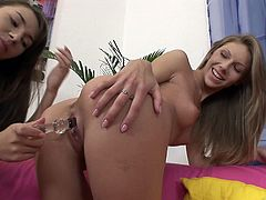 Skinny brown-haired lesbians Abbie and Stacy Snake are having a nice time together. The cuties lick and finger each other's cunts and bumholes, then test their new glass dildo.