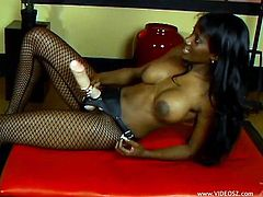 The gorgeous ebony babe Nyomi Banxxx wears some sexy fishnet stockings and enjoys pegging this horny white dude with a huge strap on.