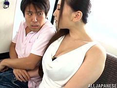 A stunning Japanese girl with a big booty and juicy boobs has an affair in a train. She lifts a skirt up and gets fingered by a stranger. Then this babe gives a blowjob to the lucky man.