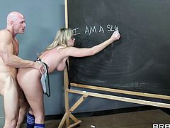 A sizzling hot girl with long blonde hair, big tits and a shaved pussy enjoys licking and sucking her teacher's massive cock.