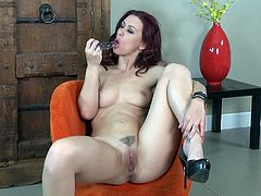 Get excited by watching this redhead cougar, with natural tits wearing high heels, while she rubs her pussy with passion until she cums.