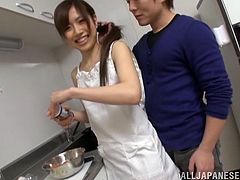 A slim Japanese girl cooks a dinner to her husband. After a meal she gives a handjob and gets fucked on a table. This girl also gets her mouth filled with sperm.