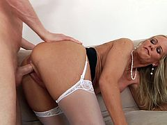 Press play to watch this blonde MILF, with natural jugs wearing nylon stockings, while she gets fucked hard in different positions.