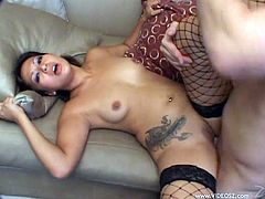 Hot Asian porn star in fishnet stockings with a tattoo gives a perfect hand job before getting her clean shaven pussy pounded