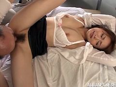 Check this Asian cougar, with a hairy love tunnel wearing a cute bra, while she goes hardcore with a naughty fellow in a reality video.