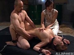 The gorgeous Japanese slave Wakaba Onoue gets tied up and enjoys a big hard cock up her hairy little pussy in this nasty BDSM session.