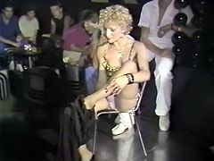 Naughty striptease dancer shows off her seductive body