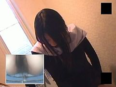 A voyeur has hidden a cam in this toilet. A Japanese girl comes in and starts masturbating while sitting on the toilet.