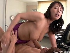 Share this with your friends! An Asian brunette, with big knockers wearing a pretty bra, while she goes hardcore with a crazy guy.
