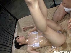 Get a boner by watching this Asian cougar, with natural breasts wearing a white bikini, while she gets her love tunnel really wet with a toy.
