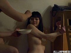 A lewd man is having fun with a nude Japanese milf, tied up in the bedroom. The guy pleases the hussy with fingering, then fucks her coochie with a dildo.