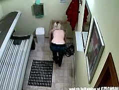 This blonde girl from the Czech Republic wanted to get tanned, so she went to the solarium. She got naked and laid on the tanning bed. A spy cam filmed this.