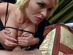 Get a hard dick by watching this blonde cougar, with big love pillows wearing fishnet stockings, while she goes hardcore with a vampire.