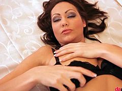 Jennifer Max is a brunette beauty with long legs. She strips very slowly out of her sexy black lingerie, while laying on a bed. She touches her pussy lightly.