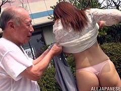 Charming Japanese girl is getting naughty with an elderly guy in the garden. She pleases the dude with a blowjob, then they go indoors and make love in the missionary position.