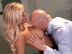 A very sexy blonde cougar with long hair, big fake tits and a hot body enjoys getting her wet pussy licked in her office.