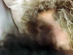 Light and curly haired filthy hottie rests on sofa with legs spread apart and watches her kinky brunette kooky eating her flaccid wet kitty. Have a look at that dirty lesbo sex in The Classic Porn sex video!