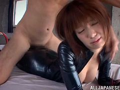Witness this reality video where a Japanese babe, with natural jugs wearing a leather outfit, gets banged hard in different positions.