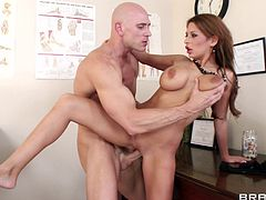 Busty dark-haired milf Allison Star gives a blowjob and a titjob to Johnny Sins. After that they fuck in the standing and the cowgirl pose and Allison's big fake boobs jiggle so nicely.