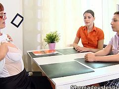 Marina and her sexy female classmate are struggling for grades, and visit their lesbian older teacher. Their teacher takes off her top and then encourages Marina to remove her friends shirt. Marina licks and sucks her friends breasts and their lesbian teacher uses a vibrator on her pussy. Marina then takes off her clothes, and is fucked deep by her friend and teacher with a glass dildo in her pussy. Marina has her wet pussy eaten out and breasts played with a lot. Marina gets her pussy eaten out by her friend and both of these girls are made lesbians today.
