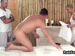 Professional blonde masseuse in threesome