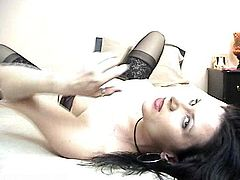 Kinky brunette mom, wearing lingerie and stockings, is having a good time indoors. She smokes a cigarette seductively, then shows her shaved pussy for the cam and pleases herself with fingering.