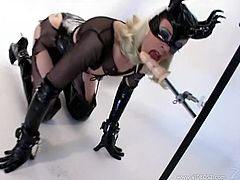 Mistress Alexandra gives her slave some rough pleasure as she shoves a dildo up his ass while she punishes him with some nasty nipple clamps.