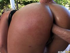 Luscious porn star cougar with big tits and long hair giving double blowjob, gets her ass oiled then gets a steamy double penetration