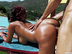 Sexy brunette Priya Anjali Rai, wearing a bikini, lets Karlo Karerra massage her hot body on the poolside. After that they bang in the reverse cowgirl pose and Priya gets cum on her tits.