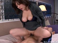 Witness this video where an Asian babe, with big gazongas wearing a cute bra, has clothed sex with a naughty fellow and moans like a bitch.