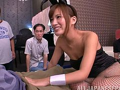 Take a nice look at this Asian brunette, with natural tits wearing fishnet stockings, while she goes hardcore with several men in a wild gangbang.